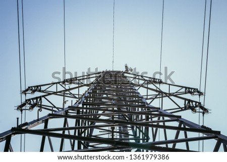 Picture of an electrical tower or pylon, blue sky in the background. Power grid or smart grid.  #1361979386