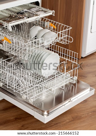 Picture of an opened dishwasher in the kitchen