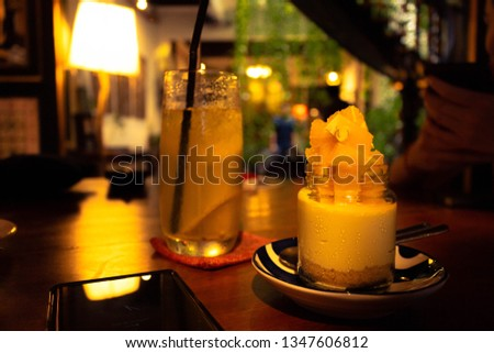 Picture of An Orange Cheesecake with A glass of Lime Juice as complement