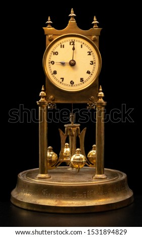 Picture of an original 100 years old so called anniversary or clock 400 days clock german text on the base