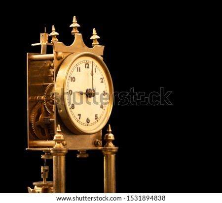 Picture of an original 100 years old so called anniversary or clock 400 days clock german text on the base 2