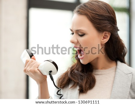 picture of angry businesswoman shouting at phone