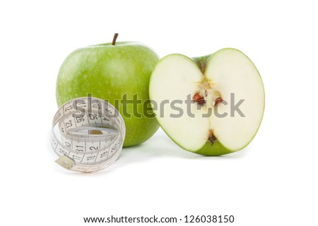 Picture of apples and tape measure on the green background