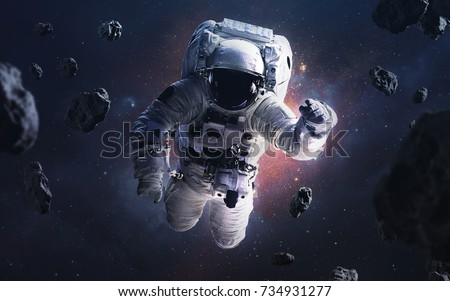 Picture of astronaut spacewalking with glowing stars and asteroids. Deep space image, science fiction fantasy in high resolution ideal for wallpaper and print. Elements of this image furnished by NASA