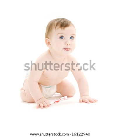 picture of baby boy in diaper with toothbrush sticking tongue out