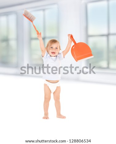 picture of baby boy with with dustpan and brush
