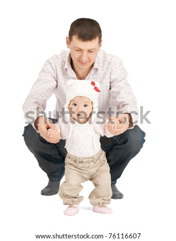 picture of baby making first steps with father help