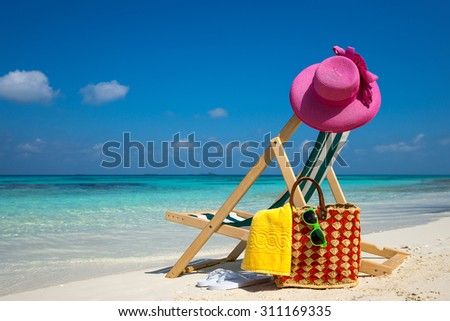 Picture of Beach lounger on the tropical beach, vacation. Traveler dreams concept