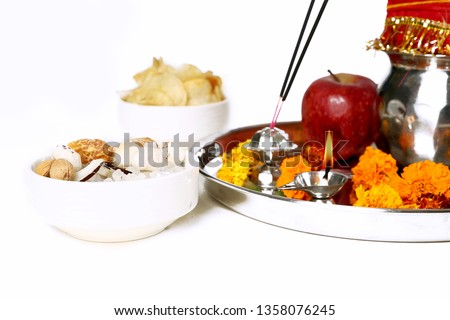 Picture of beautiful Decorated Pooja Thali for festival. Picture of dry fruit and chips for navratri festival. Isolated on the white background.