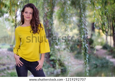 Picture of beautiful female over sunset, closeup portrait of cute romantic girl, attractive brunette woman enjoying autumn yellow sunlight, pretty young lady outdoors rejoice of warm weather fall.