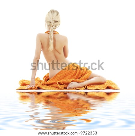 picture of beautiful lady with orange towels on white sand - stock photo