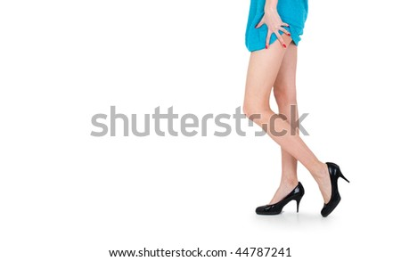Picture of beautiful legs with black shoes over white background