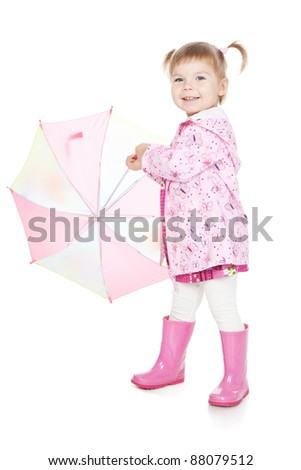 Picture of beautiful little girl in pink boots with umbrella over white