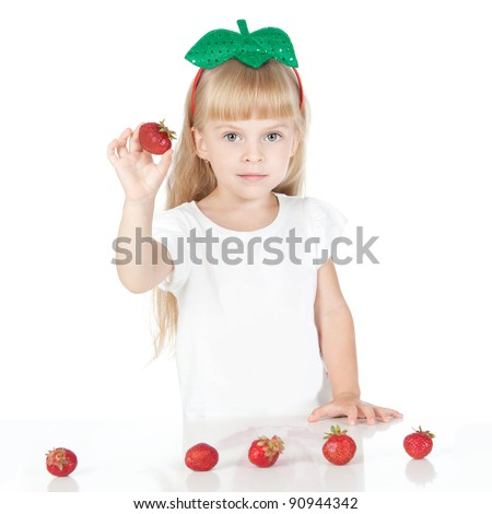 Picture of beautiful little girl with strawberry over white