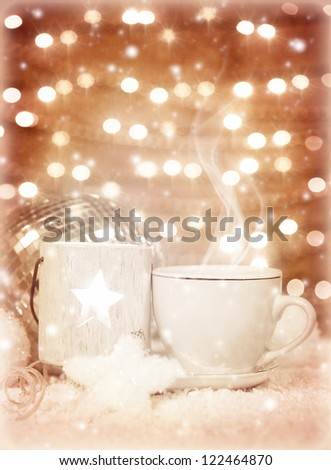 Picture of beautiful luxury white cup of tea on festive glow background, New Year greeting card, home Christmastime decor, hot chocolate drink, restaurant table setting, winter holidays