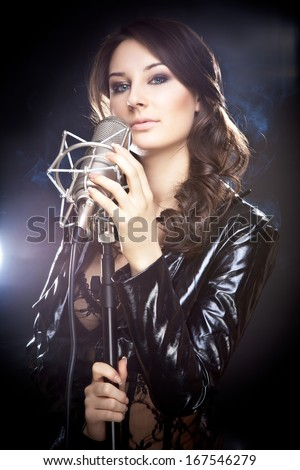 Picture of beautiful singer with studio microphone