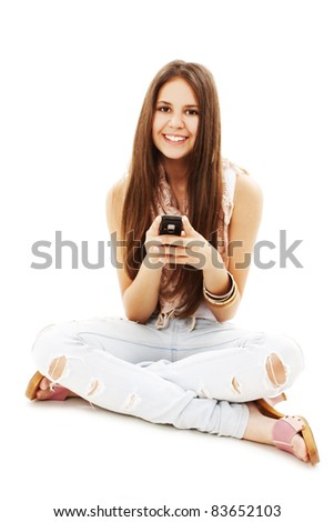Picture of beautiful teenage girl with cell phone. All on white background.