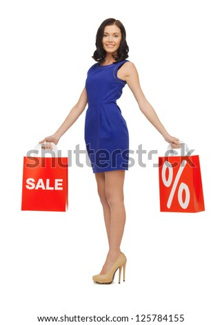 picture of beautiful woman in blue dress with shopping bag