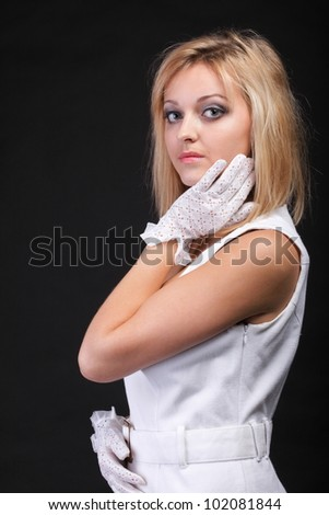 picture of beautiful woman in white gloves black background