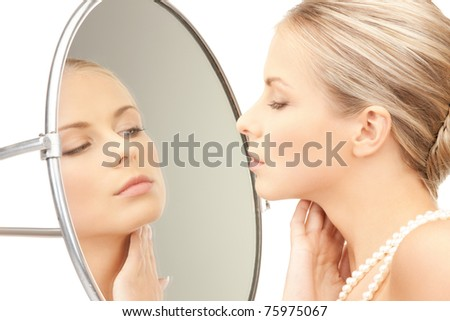 picture of beautiful woman with pearl beads and mirror