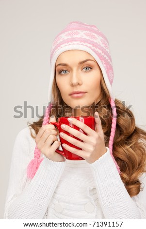 picture of beautiful woman with red mug