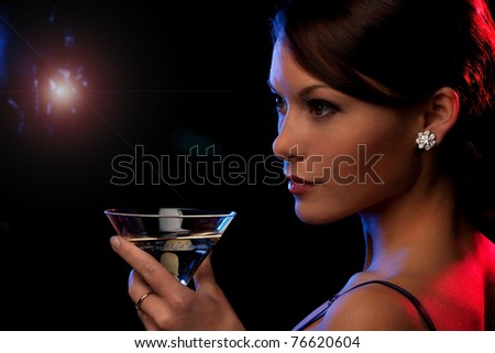 picture of beautiful young woman with a cocktail