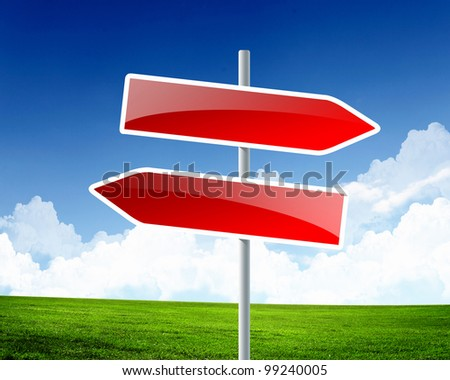 Picture of blank road signs against blue sky