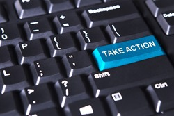 Picture of blue button with text of take action on the computer keyboard