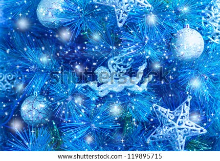 Picture of blue Christmas tree background, Christmastime fir decorations, star, bauble and angel decorated holiday spruce, happy New Year greeting card, xmas celebration, abstract wallpaper