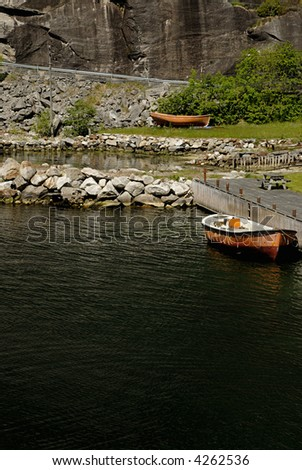 Picture of boat in dock in Lysefjord - fjord near Stavanger in Norway.