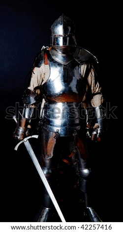 Picture of brave knight holding a sword