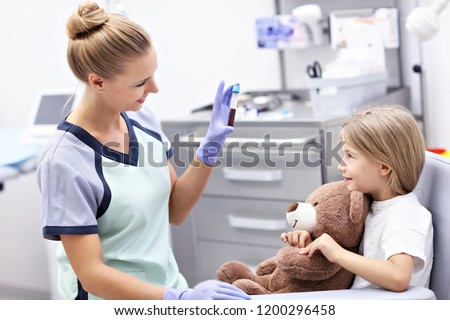 Picture of brave little girl having blood collection for tests