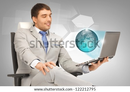 picture of businessman working with laptop and virtual screens