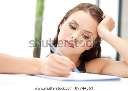 picture of calm woman with big notepad