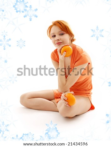 picture of cheerful redhead with two oranges