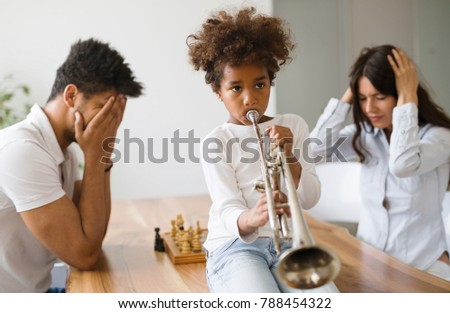 Shutterstock Picture of child making noise by playing trumpet