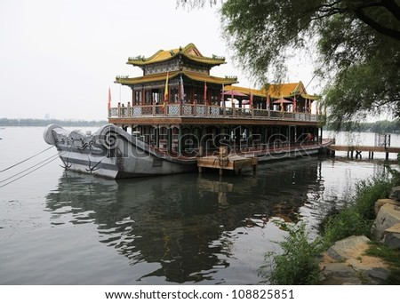 Picture of chinese traditional ancient boat parking by bank.