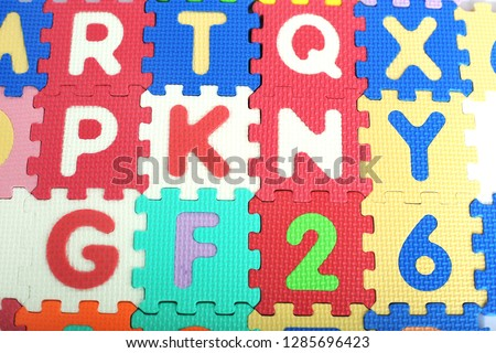 Picture of colored alphabets letters and numbers.
