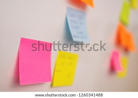 Picture of colorful paper sticker on the whiteboard on the wall #1260341488