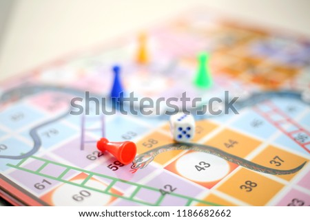 Picture of colorful snakes and Ladders board Game.