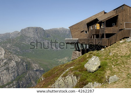 Picture of cottage on the edge of rock wall in Lysefjord, Norway.