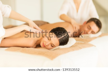 picture of couple in spa salon getting massage #139313552