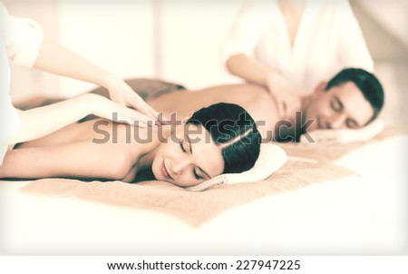 picture of couple in spa salon getting massage #227947225