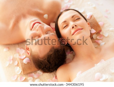 picture of couple in spa salon lying on the massage desks #344306195