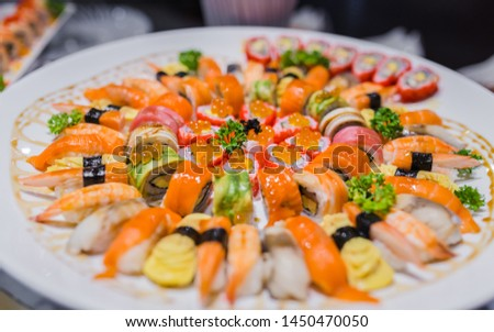 Picture of delicious sushi rolls set in a variety of japanese food