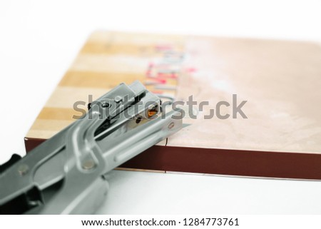 Picture of diary with stapler. Isolated on the white background.