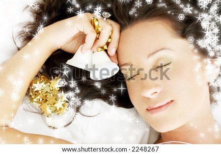 picture of dreaming girl with christmas bells surrounded by rendered snowflakes - stock photo