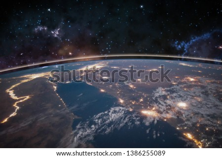 Picture of Earth in space, stars all around, night sky. Elements of this image furnished by NASA. #1386255089