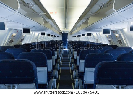 Picture of empty passenger seats inside airplane #1038476401