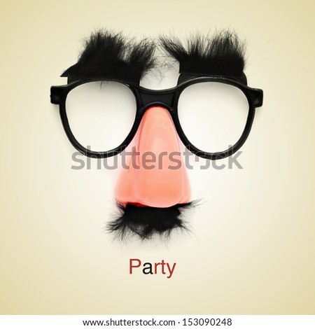 picture of fake glasses, nose and mustache and the word party on a beige background, with a retro effect Stock photo ©